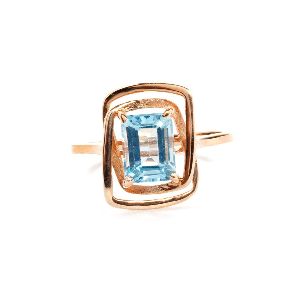 Золотое кольцо с голубым топазом огранки багет